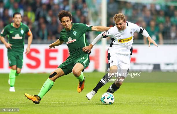 Christoph Kramer of Borussia Moenchengladbach is challenged by Thomas Delaney of Werder Bremen during the Bundesliga match between SV Werder Bremen...