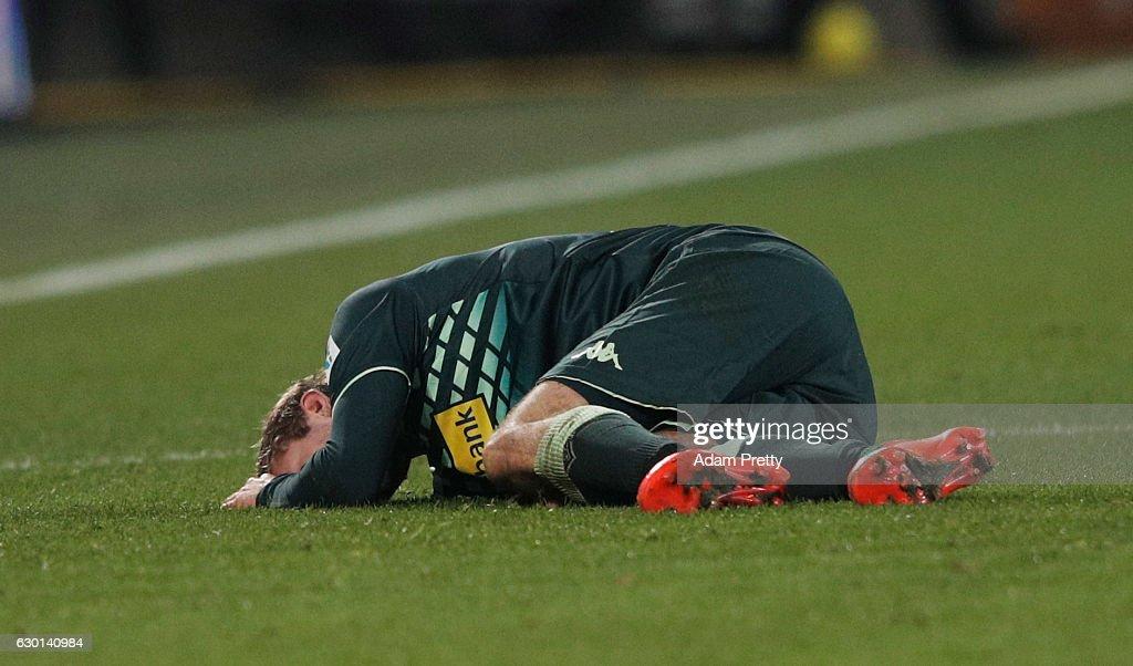 Christoph Kramer of Borussia Moenchengladbach is injured during the Bundesliga match between FC Augsburg and Borussia Moenchengladbach at WWK Arena on December 17, 2016 in Augsburg, Germany.