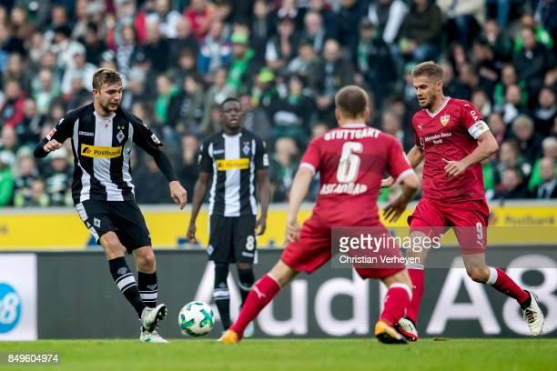 Christoph Kramer of Borussia Moenchengladbach Simon Terodde and Santiago Ascacibar of VfB Stuttgart battle for the ball during the Bundesliga match...