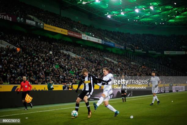 Christoph Kramer of Borussia Monchengladbach battles for the ball with Bastian Oczipka of Schalke 04 during the Bundesliga match between Borussia...