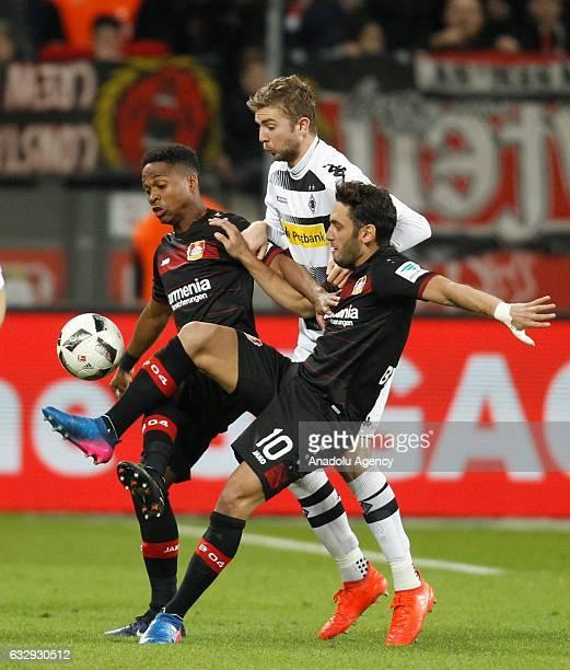 Christoph Kramer of Borussia Monchengladbach challenges with Benjamin Hofmann and Hakan Calhanoglu of Bayer Leverkusen during the Bundesliga soccer...