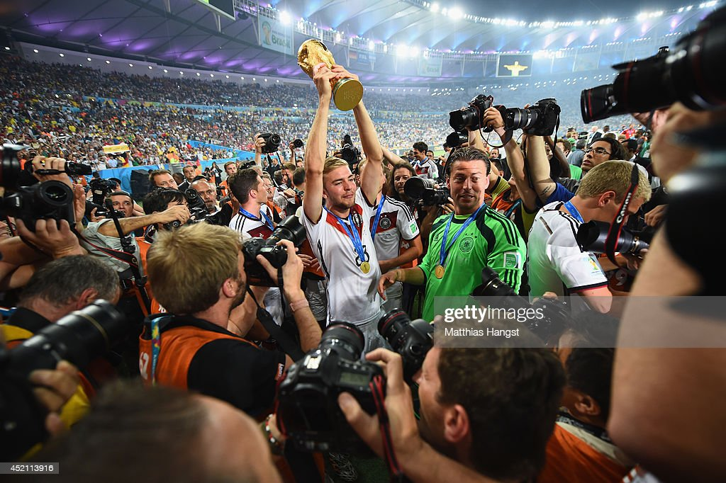 Christoph Kramer of Germany raises the World Cup trophy after defeating Argentina 1-0 in extra time during the 2014 FIFA World Cup Brazil Final match between Germany and Argentina at Maracana on July 13, 2014 in Rio de Janeiro, Brazil.