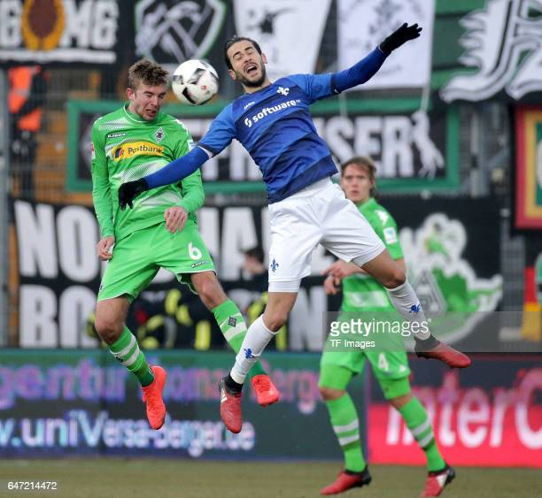 Christoph Kramer of Gladbach and Mario Vrancic of Darmstadt battle for the ball during the Bundesliga match between SV Darmstadt 98 and Borussia...