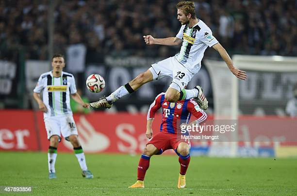 Christoph Kramer of Gladbach kicks the ball during the Bundesliga match between Borussia Moenchengladbach and FC Bayern Muenchen at Borussia Park on...