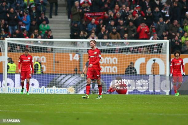 Christoph Kramer of Leverkusen reacts with his team mates after receiving the 2nd goal during the Bundesliga match between FC Augsburg and Bayer...