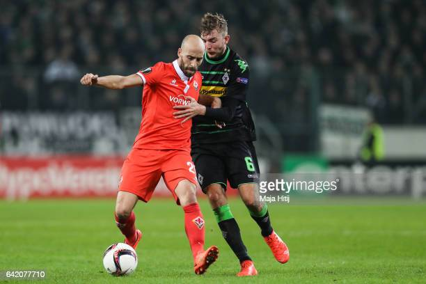 Christoph Kramer of Moenchengladbach and Borja Valero of Fiorentina battle for the ball during the UEFA Europa League Round of 32 first leg match...