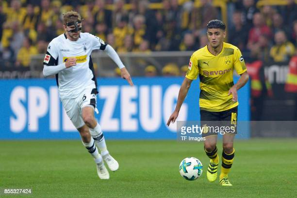 Christoph Kramer of Moenchengladbach and Mahmoud Dahoud of Dortmund battle for the ball during the Bundesliga match between Borussia Dortmund and...