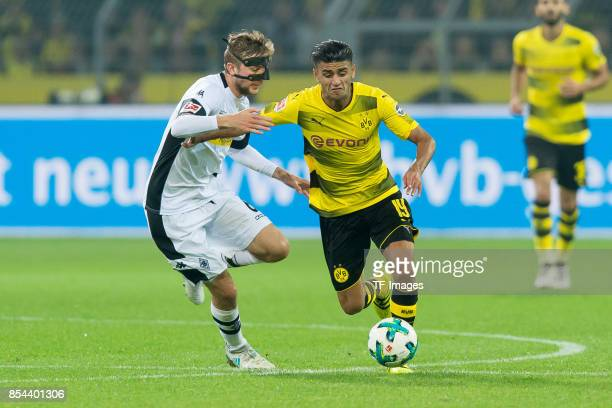 Christoph Kramer of Moenchengladbach and Mahmound Dahoud of Dortmund battle for the ball during the Bundesliga match between Borussia Dortmund and...