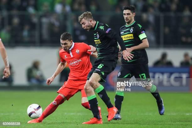 Christoph Kramer of Moenchengladbach and Sebastian Cristoforo of Fiorentina battle for the ball during the UEFA Europa League Round of 32 first leg...