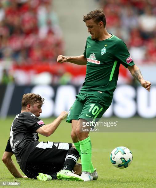Christoph Kramer of Moenchengladbach challenges Max Kruse of Bremen during the Telekom Cup 2017 match between Borussia Moenchengladbach and Werder...