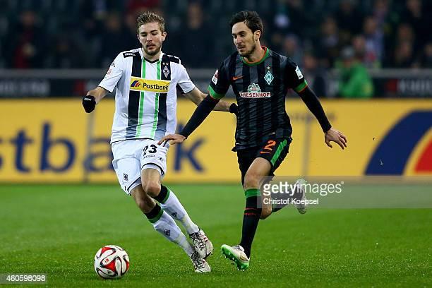 Christoph Kramer of Moenchengladbach challenges Santiago Garcia of Bremen during the Bundesliga match between Borussia Moenchengladbach and Werder...
