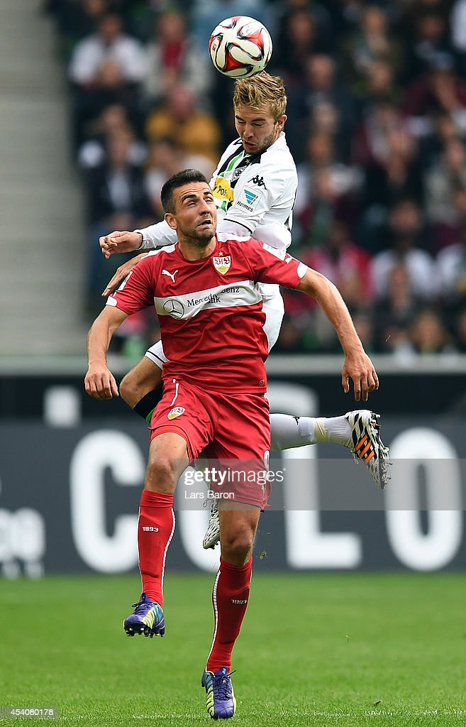 <a gi-track='captionPersonalityLinkClicked' href=/galleries/search?phrase=Christoph+Kramer&family=editorial&specificpeople=5588926 ng-click='$event.stopPropagation()'>Christoph Kramer</a> of Moenchengladbach goes up for a header with <a gi-track='captionPersonalityLinkClicked' href=/galleries/search?phrase=Vedad+Ibisevic&family=editorial&specificpeople=535857 ng-click='$event.stopPropagation()'>Vedad Ibisevic</a> of Stuttgart during the Bundesliga match between Borussia Moenchengladbach and VfB Stuttgart at Borussia Park Stadium on August 24, 2014 in Moenchengladbach, Germany.