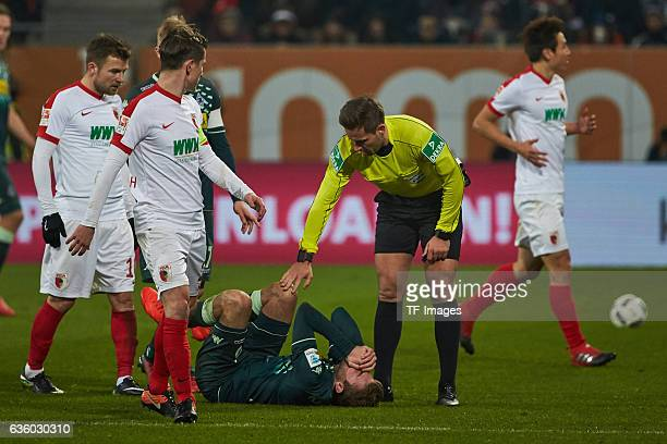 Christoph Kramer of Moenchengladbach injured during the Bundesliga match between FC Augsburg and Borussia Moenchengladbach at WWKArena on December 17...
