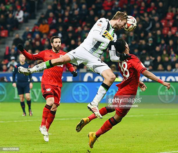 Christoph Kramer of Moenchengladbach is challenged by Wendell and Gonzalo Castro of Leverkusen during the Bundesliga match between Bayer 04...