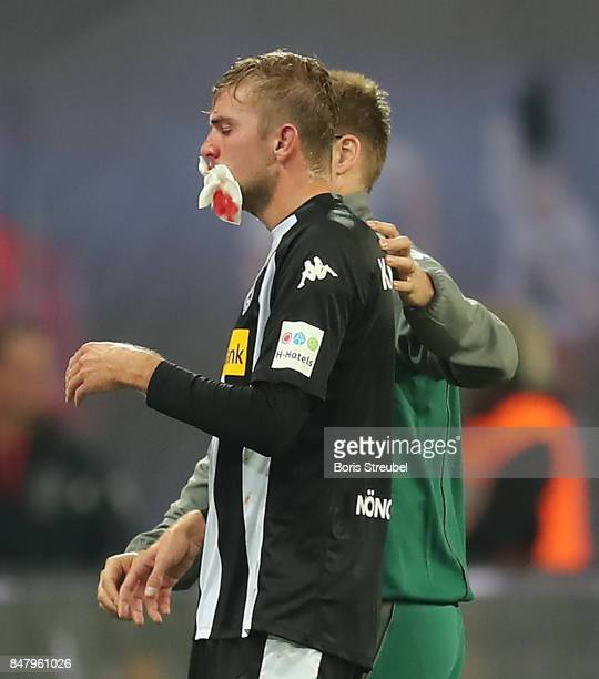 Christoph Kramer of Moenchengladbach is taken care of after a heavy foul by Naby Keita of Leipzig which result in a red card during the Bundesliga...
