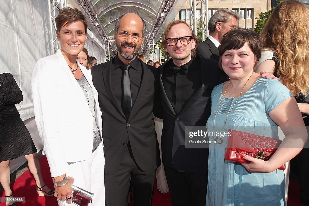 Christoph Maria Herbst and his wife Gisi Herbst, Milan Peschel and his wife Magdalena Peschel attend the Lola - German Film Award 2014 at Tempodrom on May 9, 2014 in Berlin, Germany.