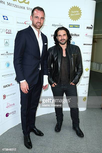Christoph Metzelder and Marc Terenzi pose during the pre golf party of the 7th Golf Charity Cup hosted by the Christoph Metzelder Foundation on May...
