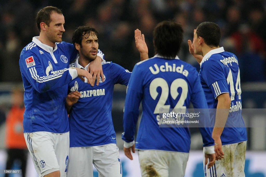Christoph Metzelder of Schalke and teammates Raul Gonzalez Atsuto Uchida and Kyriakos Papadopoulos celebrates after KlaasJan Huntelaar has scored his...