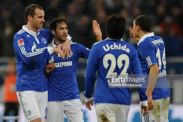 Christoph Metzelder of Schalke and teammates Raul Gonzalez Atsuto Uchida and Kyriakos Papadopoulos celebrates after KlaasJan Huntelaar has scored his...