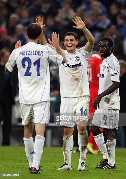 Christoph Metzelder of Schalke Kyriakos Papadopoulos and Hans Sarpei celebrate the 20 victory after the UEFA Champions League match between FC...