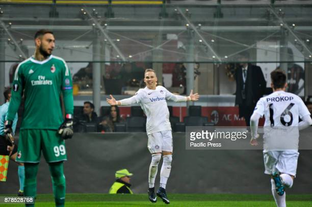 Christoph Monschein of FK Austria Wien celebrate the first goal for FK Austria Wien during uefa Europa League AC Milan vs FK Austria Wien at San Siro...