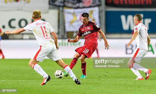 Christoph Moritz of FC Kaiserslautern challenges Axel Bellinghausen of Fortuna Duesseldorf and Oliver Fink of Fortuna Duesseldorf during the Second...