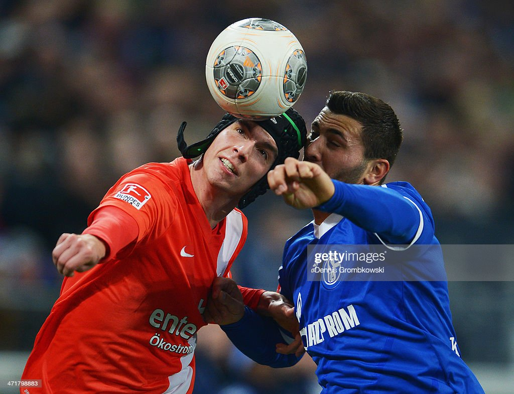 <a gi-track='captionPersonalityLinkClicked' href=/galleries/search?phrase=Christoph+Moritz&family=editorial&specificpeople=6144711 ng-click='$event.stopPropagation()'>Christoph Moritz</a> of FSV Mainz 05 and Sead Kolasinac of FC Schalke 04 battle for the ball during the Bundesliga match between FC Schalke 04 and FSV Mainz 05 at Veltins-Arena on February 21, 2014 in Gelsenkirchen, Germany.