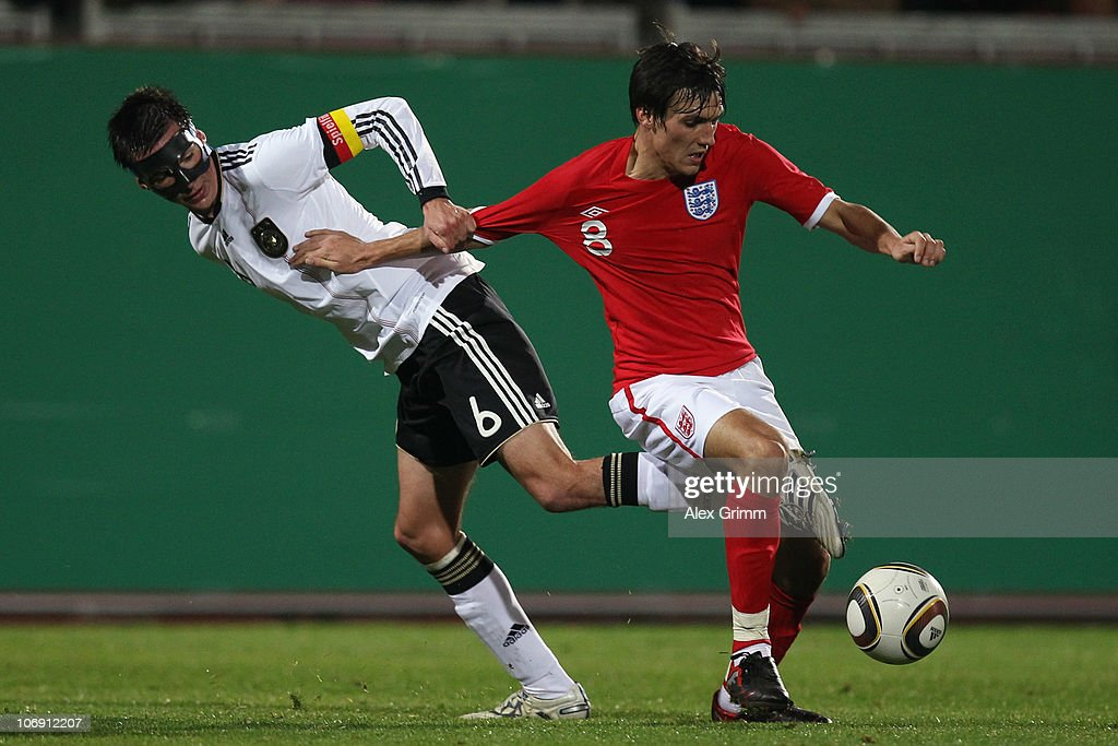 Christoph Moritz (L) of Germany is challenged by Jack Cork of England during the U21 international friendly match between Germany and England at the Brita Arena on November 16, 2010 in Wiesbaden, Germany.