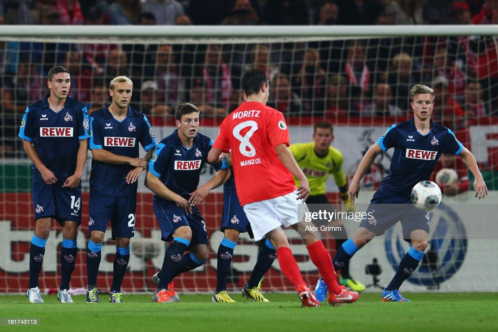 <a gi-track='captionPersonalityLinkClicked' href=/galleries/search?phrase=Christoph+Moritz&family=editorial&specificpeople=6144711 ng-click='$event.stopPropagation()'>Christoph Moritz</a> of Mainz shoots a free-kick during the DFB Cup second round match between 1. FSV Mainz 05 and 1. FC Koeln at Coface Arena on September 24, 2013 in Mainz, Germany.