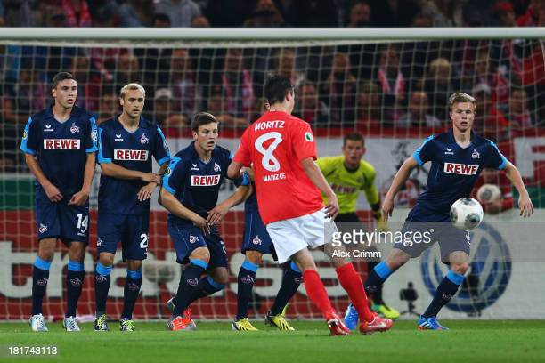 Christoph Moritz of Mainz shoots a freekick during the DFB Cup second round match between 1 FSV Mainz 05 and 1 FC Koeln at Coface Arena on September...