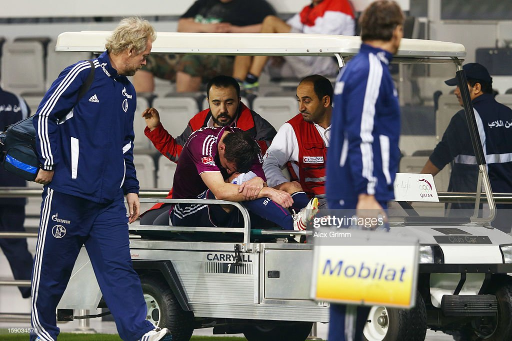 Christoph Moritz of Schalke is brought off the pitch on a golf cart during the friendly match between Al-Sadd Sports Club and FC Schalke 04 at Jassim Bin Hamad Stadium on January 6, 2013 in Doha, Qatar.