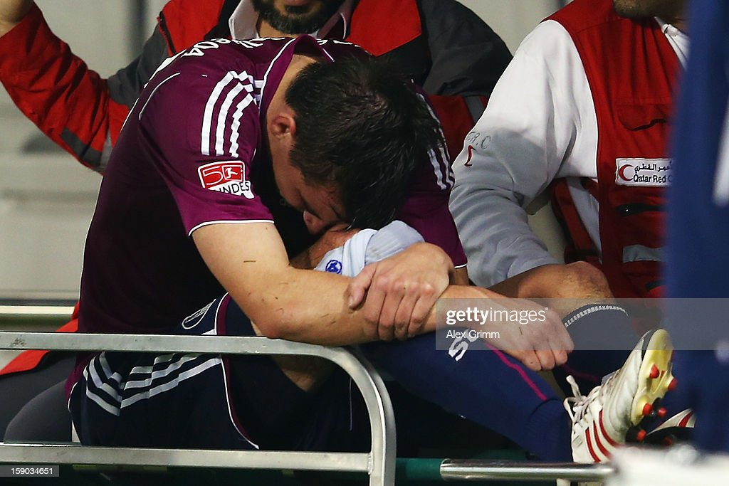 <a gi-track='captionPersonalityLinkClicked' href=/galleries/search?phrase=Christoph+Moritz&family=editorial&specificpeople=6144711 ng-click='$event.stopPropagation()'>Christoph Moritz</a> of Schalke reacts as he is brought off the pitch on a golf cart during the friendly match between Al-Sadd Sports Club and FC Schalke 04 at Jassim Bin Hamad Stadium on January 6, 2013 in Doha, Qatar.