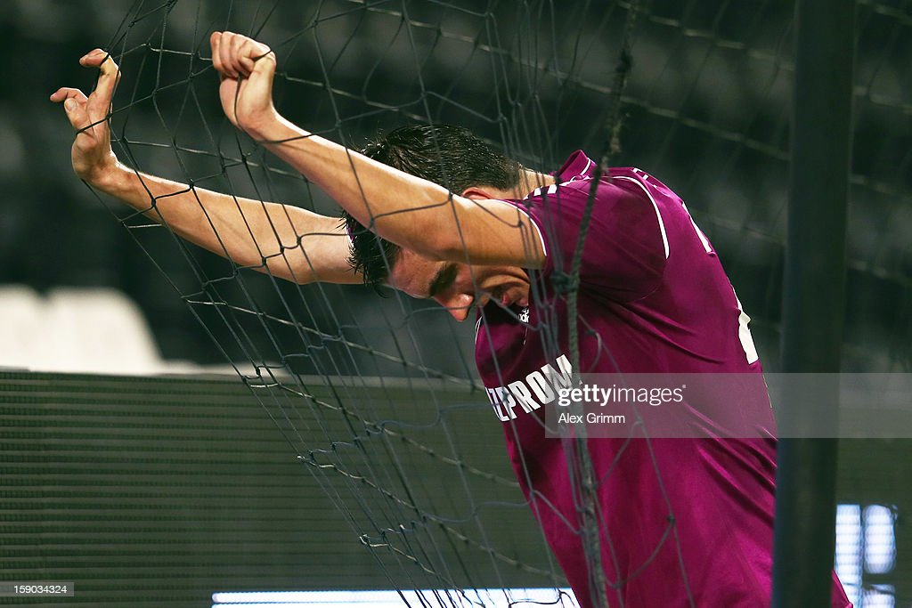 <a gi-track='captionPersonalityLinkClicked' href=/galleries/search?phrase=Christoph+Moritz&family=editorial&specificpeople=6144711 ng-click='$event.stopPropagation()'>Christoph Moritz</a> of Schalke reacts during the friendly match between Al-Sadd Sports Club and FC Schalke 04 at Jassim Bin Hamad Stadium on January 6, 2013 in Doha, Qatar.