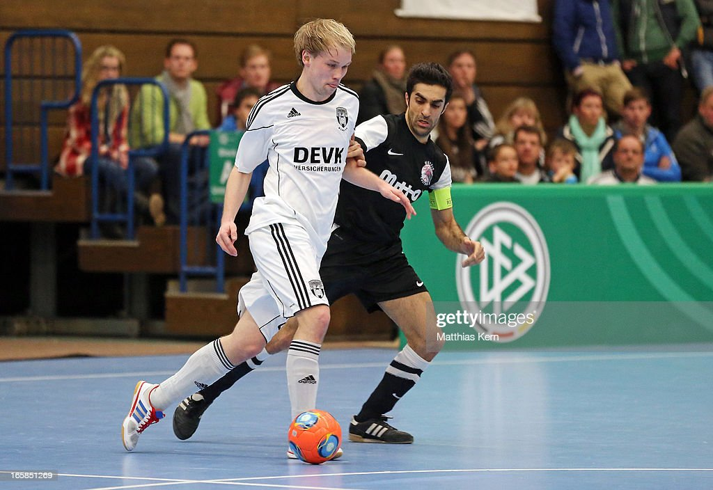 Christoph Rueschenpoehler (L) of Muenster battles for the ball with Sascha Enrico de la Cuesta Seco (R) of Hamburg during the DFB Futsal Cup final match between Hamburg Panthers and UFC Muenster at Sporthalle Wandsbek on April 6, 2013 in Hamburg, Germany.
