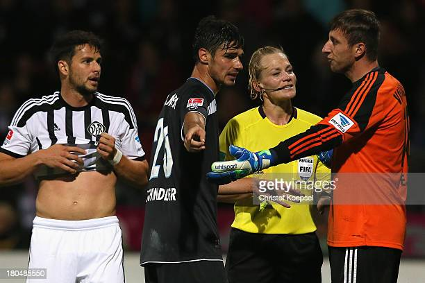 Christoph Schindler of Muenchen referee Bibiana Steinhaus and Jasmin Fejzic of Aalen discuss during the Second Bundesliga match between VfR Aalen and...