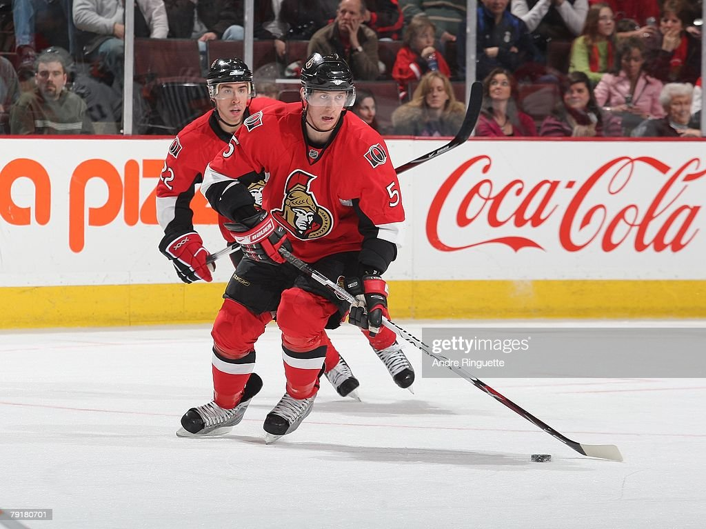 Christoph Schubert and Chris Kelly of the Ottawa Senators skate up ice with the puck against the Tampa Bay Lightning at Scotiabank Place on January...