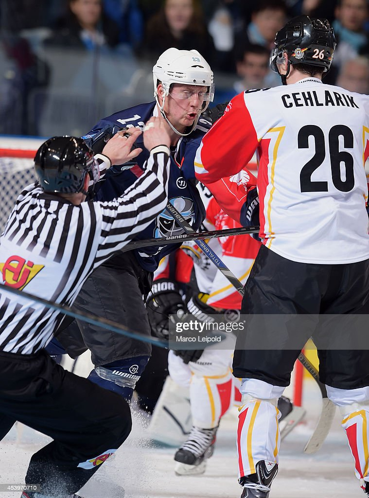Christoph Schubert #13 of Hamburg Freezers and Peter Cehlarik #26 of Lulea Hockey fight during the Champions Hockey League group stage game between Hamburg Freezers and Lulea HF on August 22, 2014 in Hamburg, Germany.