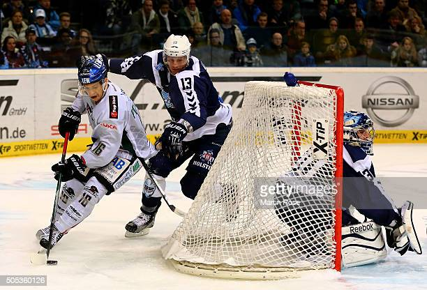 Christoph Schubert of Hamburg Freezers battles for the puck with Aleksander Polaczek of Augsburger Panthers during the DEL game between Hamburg...