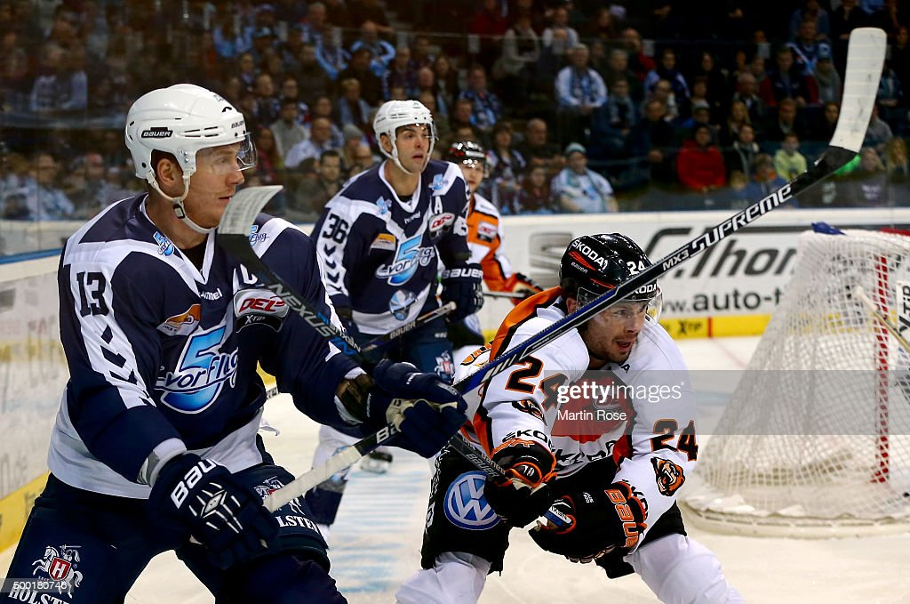 <a gi-track='captionPersonalityLinkClicked' href=/galleries/search?phrase=Christoph+Schubert+-+Ice+Hockey+Player&family=editorial&specificpeople=228722 ng-click='$event.stopPropagation()'>Christoph Schubert</a> (L) of Hamburg Freezers battles for the puck with Timm Wallace of Grizzly Wolfsburg during the DEL game between Hamburg Freezers and Grizzlys Wolfsburg at Barclaycard Arena on December 6, 2015 in Hamburg, Germany.