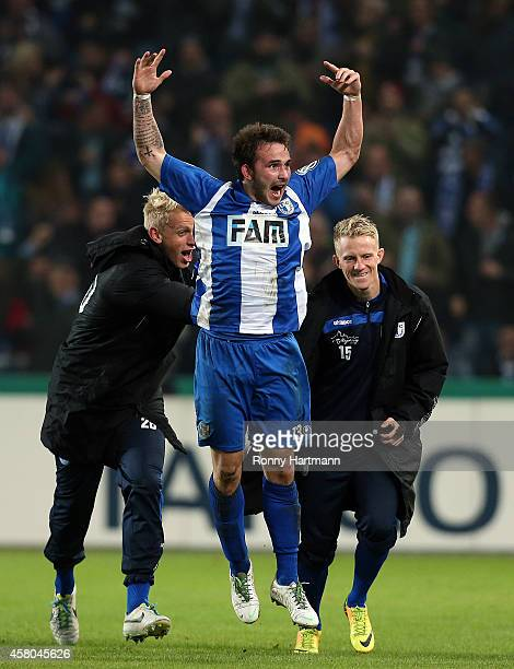 Christoph Siefkes of Magdeburg celebrates after scoring his team's first goal during the DFB Cup second round match between 1 FC Magdeburg and Werder...