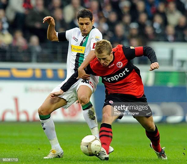 Christoph Spycher of Frankfurt battles for the ball with Karim Matmour of Moenchengladbach during the Bundesliga match between Eintracht Frankfurt...