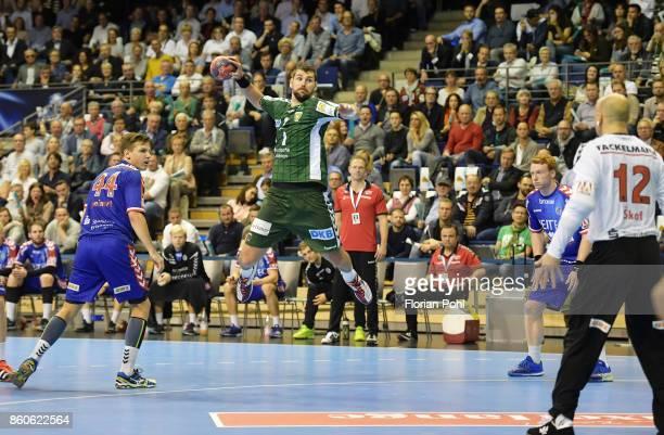 Christoph Steinert of HC Erlangen Jakov Gojun of Fuechse Berlin Nicolai Theilinger and Gorazd Skof of HC Erlangen during the game between Fuechse...
