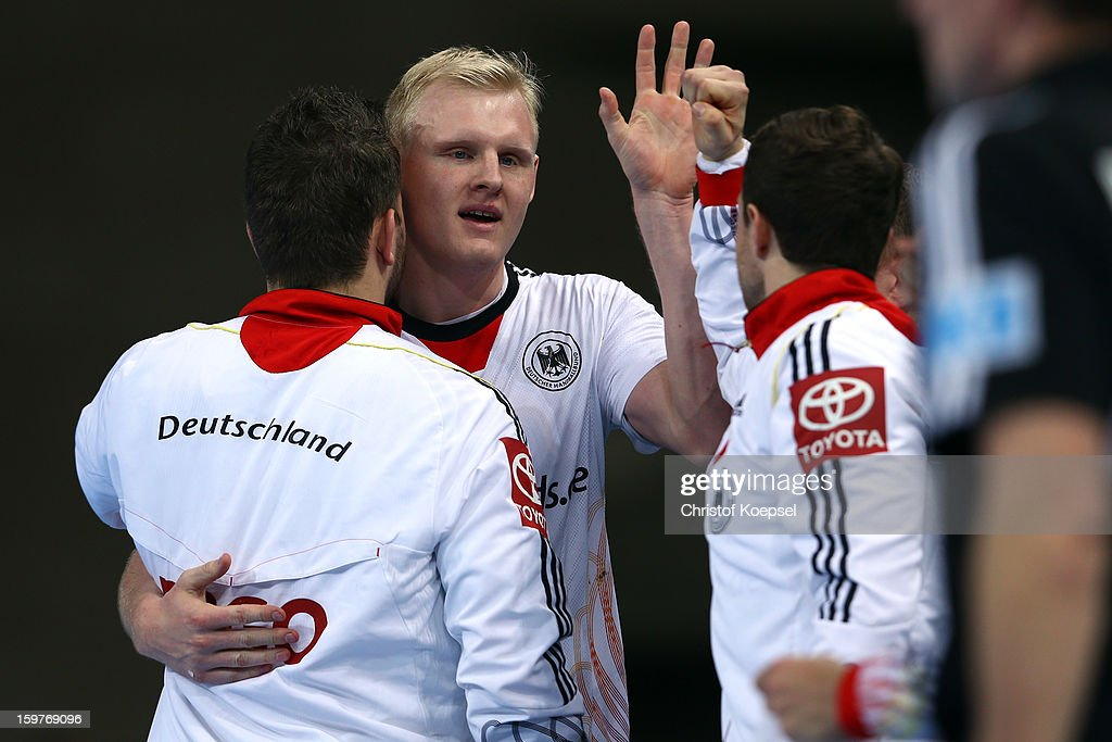 Christoph Theuerkauf, Patrick Wiencek and Martin Strobel of Germany celebrate during the round of sixteen match between Germany and Macedonia at Palau Sant Jordi on January 20, 2013 in Barcelona, Spain.