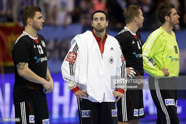 Christoph Theuerkauf Silvio Heinevetter Oliver Roggisch and Carsten Lichtlein of Germany look dejected after the premilary group A match between...