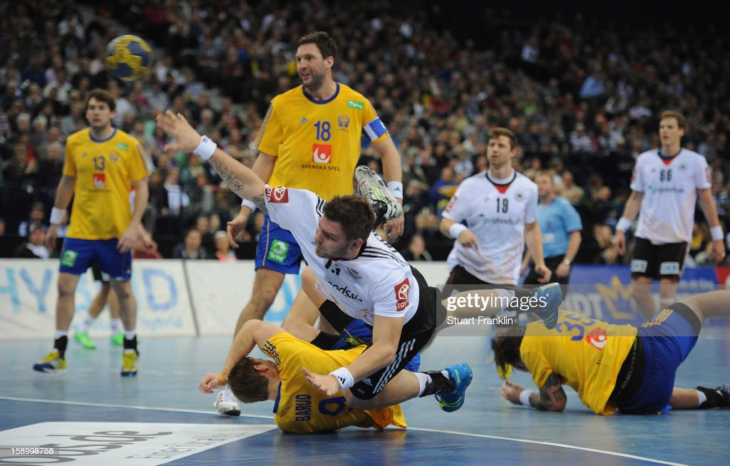 Christoph Theurerkauf of Germany challenges for the ball with Jonathan Jakobsson of Sweden during the international handball friendly match between Germany and Sweden at O2 World on January 5, 2013 in Hamburg, Germany.