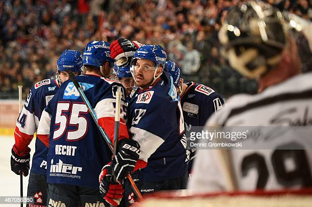 Christoph Ullmann of Adler Mannheim celebrates as he scores their third goal during the DEL Ice Hockey Playoffs Quarter Final Game 5 between Alder...