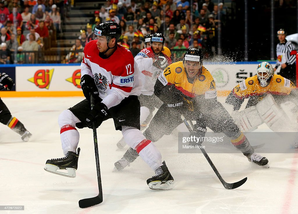 Christoph Ullmann (R) of Germany and Michael Raffl (L) of Austria battle for the puck during the IIHF World Championship group A match between Germany and Austria at o2 Arena on May 11, 2015 in Prague, Czech Republic.