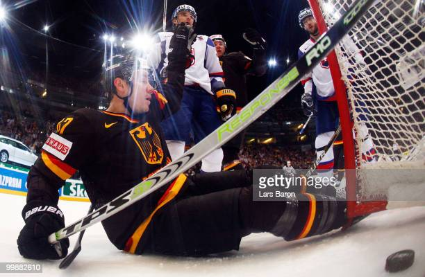 Christoph Ullmann of Germany celebrates after scoring a irregular goal with his foot past goaltender Peter Budaj of Slovakia during the IIHF World...