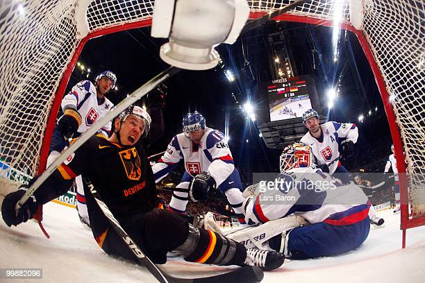 Christoph Ullmann of Germany scores an irregular goal with his foot past goaltender Peter Budaj of Slovakia during the IIHF World Championship...