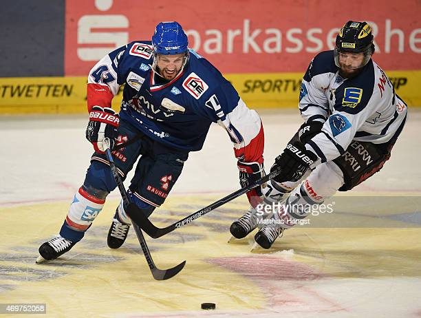 Christoph Ullmann of Mannheim is challenged by Dustin Friesen of Ingolstadt during the DEL Playoffs Final Game 3 between Adler Mannheim and ERC...